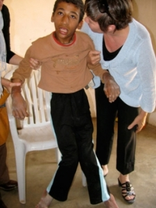 16-year-old crippled boy who has never had a wheelchair and is pulled around with rope due to illness.