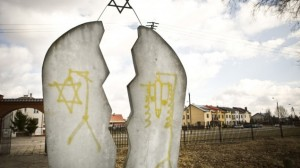 A monument found desecrated with anti-Semitic graffiti at a Jewish cemetery in Wysokie Mazowieckie, Poland.